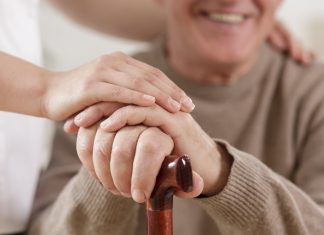 Helpful carer and happy old man